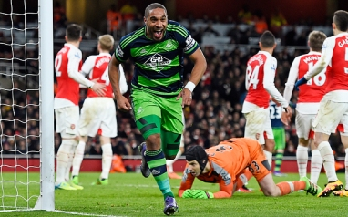 """Football Soccer - Arsenal v Swansea City - Barclays Premier League - Emirates Stadium - 2/3/16 Ashley Williams celebrates scoring the second goal for Swansea City Reuters / Dylan Martinez Livepic EDITORIAL USE ONLY. No use with unauthorized audio, video, data, fixture lists, club/league logos or """"live"""" services. Online in-match use limited to 45 images, no video emulation. No use in betting, games or single club/league/player publications. Please contact your account representative for further details."""