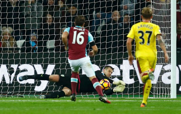 burnleys-tom-heaton-saves-a-penalty-from-west-ham-uniteds-mark-noble