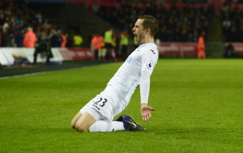 Swansea City's Gylfi Sigurdsson celebrates scoring their second goal
