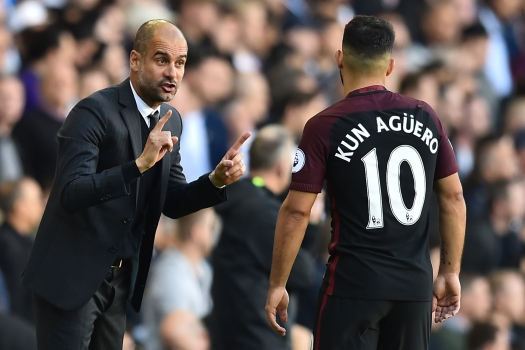 Manchester City's Spanish manager Pep Guardiola (L) gestures to Manchester City's Argentinian striker Sergio Aguero during the English Premier League football match between Tottenham Hotspur and Manchester City at White Hart Lane in London, on October 2, 2016. / AFP / Glyn KIRK / RESTRICTED TO EDITORIAL USE. No use with unauthorized audio, video, data, fixture lists, club/league logos or 'live' services. Online in-match use limited to 75 images, no video emulation. No use in betting, games or single club/league/player publications. / (Photo credit should read GLYN KIRK/AFP/Getty Images)