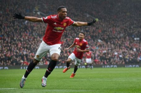 Manchester United's French striker Anthony Martial celebrates after scoring the opening goal of the English Premier League football match between Manchester United and Tottenham Hotspur at Old Trafford in Manchester, north west England, on October 28, 2017. / AFP PHOTO / Oli SCARFF / RESTRICTED TO EDITORIAL USE. No use with unauthorized audio, video, data, fixture lists, club/league logos or 'live' services. Online in-match use limited to 75 images, no video emulation. No use in betting, games or single club/league/player publications. / (Photo credit should read OLI SCARFF/AFP/Getty Images)