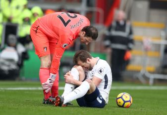 BOURNEMOUTH, ENGLAND - MARCH 11: Asmir Begovic of AFC Bournemouth speaks to Harry Kane of Tottenham Hotspur as he goes down injured during the Premier League match between AFC Bournemouth and Tottenham Hotspur at Vitality Stadium on March 11, 2018 in Bournemouth, England. (Photo by Catherine Ivill/Getty Images)