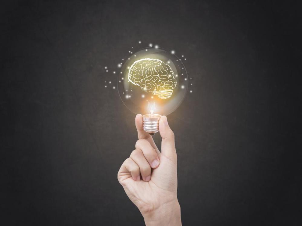 hand-holding-brain-lightbulb